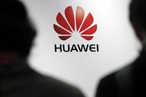Journalists attend the presentation of the Huawei's new smartphone, the Ascend P7, launched by China's Huawei Technologies in Paris
