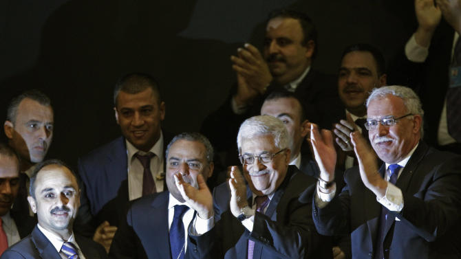 Members of the Palestinian delegation and others join Palestinian President Mahmoud Abbas by applauding during a meeting of the United Nations General Assembly after a vote on a resolution on the issue of upgrading the Palestinian Authority's status to non-member observer state passed in the United Nations in New York, Thursday, Nov. 29, 2012.   The United Nations voted overwhelmingly Thursday to recognize a Palestinian state, a long-sought victory for the Palestinians but an embarrassing diplomatic defeat for the United States.   (AP Photo/Kathy Willens)