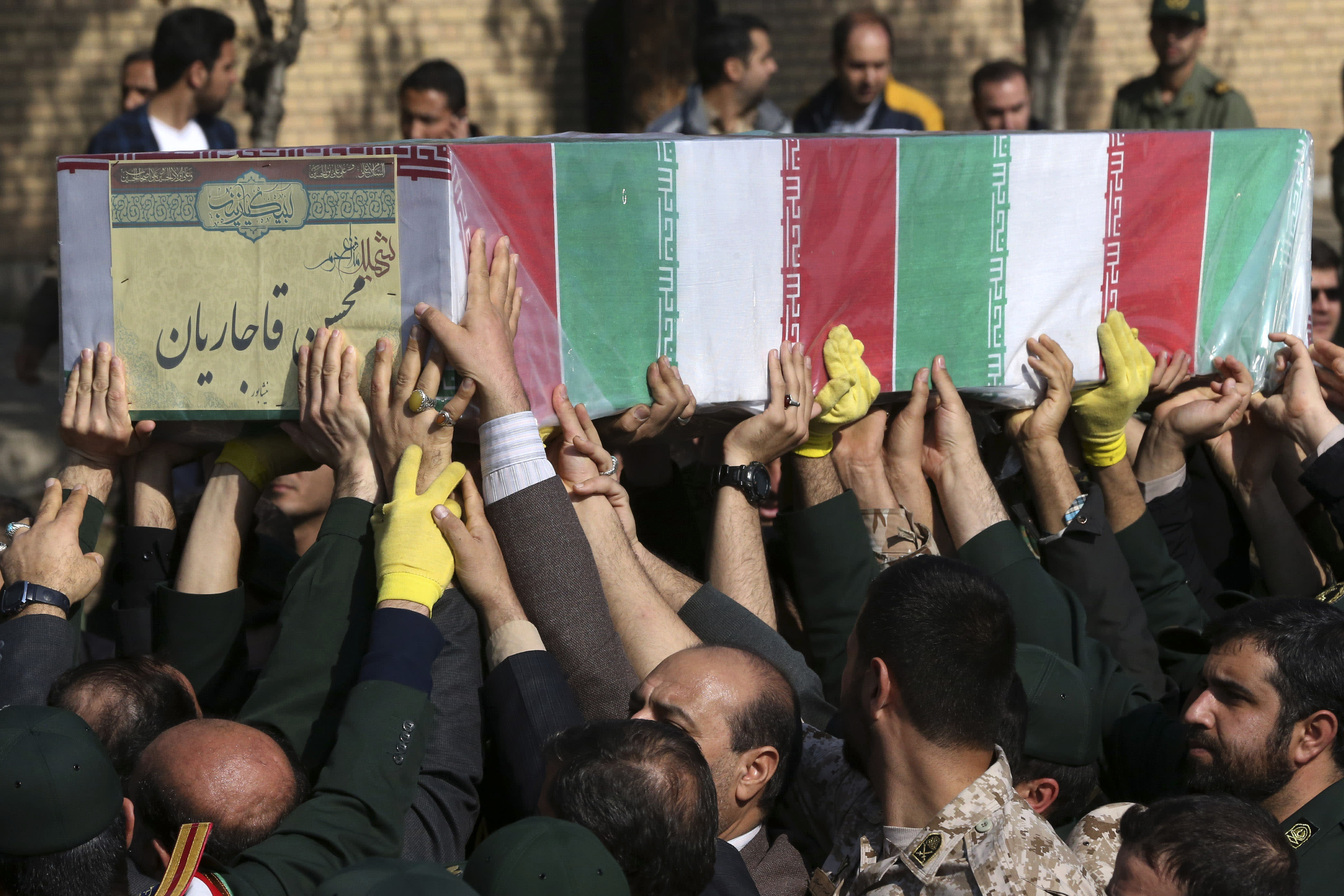 The Latest: Iran holds funeral for troops killed in Syria