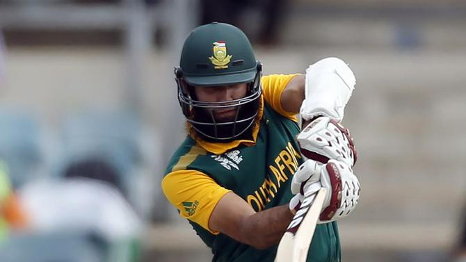 South Africa's Hashim Amla hits a boundary during the Cricket World Cup match against Ireland in Canberra