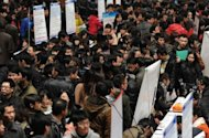 Thousands of jobseekers flock to a job fair in Hefei, east China's Anhui province on February 25, 2012. Chinese leaders frequently talk about the need to reform the country's economic model, partly by reducing its heavy reliance on exports and increasing domestic consumption