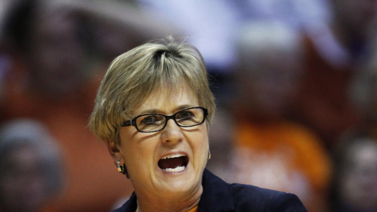 Tennessee head coach Holly Warlick yells to her team in the second half of an NCAA college basketball game against Alabama, Sunday, Jan. 20, 2013, in Knoxville, Tenn. Tennessee won 96-69. (AP Photo/Wade Payne)
