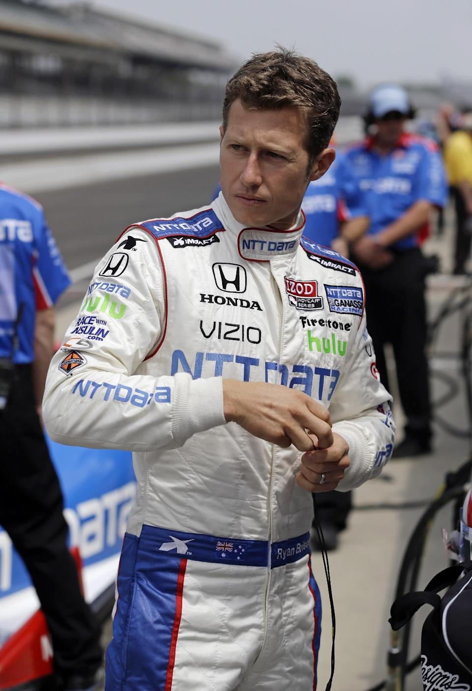 Ryan Briscoe, of Australia, looks down the pit lane as he waits for the start of practice for the Indianapolis 500 auto race at the Indianapolis Motor Speedway in Indianapolis, Friday, May 17, 2013. (AP Photo/Darron Cummings))