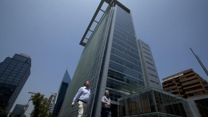 "People walk past high risers in the financial district of Santiago, Chile, Thursday, Jan. 24, 2013. European, Latin American and Caribbean leaders gathering for this weekend's economic summit will likely see only one side of Chile _ the polished, upscale country where tourists and investors stay in five-star hotels in a sparklingly clean financial district nicknamed ""Sanhattan,"" well away from Santiago's slums. (AP Photo/Victor R. Caivano)"