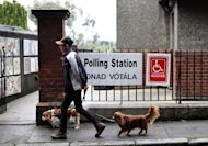 A pedestrian walks past a polling station during the Seanad (senate) referendum in Dublin, Ireland, on October 4, 2013