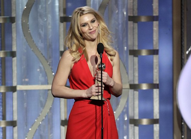This image released by NBC shows Claire Danes with her award for best actress in a TV drama series for her role in &quot;Homeland&quot; during the 70th Annual Golden Globe Awards at the Beverly Hilton Hotel on Jan. 13, 2013, in Beverly Hills, Calif. (AP Photo/NBC, Paul Drinkwater)