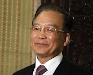 Chinese Premier Wen Jiabao has said stabilising the country&#39;s economic growth was a &quot;top priority&quot;, and authorities would encourage more investment