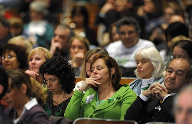 Residents of Newtown, Conn. fill an auditorium and listen during a hearing of a legislative task force on gun violence and children&#39;s safety at Newtown High School in Newtown, Conn., Wednesday, Jan. 30, 2013. Connecticut lawmakers are in Newtown for the hearing, where those invited to give testimony include first responders and families with children enrolled at Sandy Hook Elementary. (AP Photo/Jessica Hill)
