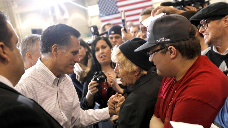 Republican presidential candidate, former Massachusetts Gov. Mitt Romney greets supporters at a town hall meeting at Eagle Manufacturing Corporation in Shelby Township, Mich., Tuesday, Mich., Feb. 21, 2012. (AP Photo/Gerald Herbert)