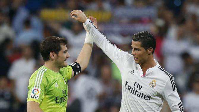 "Real Madrid's Ronaldo congratulates Real Madrid?s goalkeeper Casillas after their Spanish first division ""Clasico"" soccer match against Barcelona at the Santiago Bernabeu stadium in Madrid"