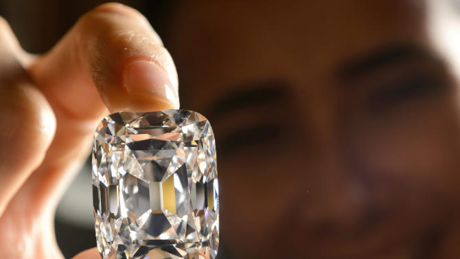 A model holds the Archduke Joseph Diamond, a historical diamond, during a Christie's auction preview, in Geneva, Switzerland. On Tuesday, Nov. 13, 2012 Christie's is selling the Archduke Joseph Diamond, one of the rarest and most famous. The 76.02 carat diamond, with perfect color and internally flawless clarity, came from the ancient Golconda mines in India.  It is expected to sell for more than $15 million. In 1993, Christie's auctioned it in Geneva where it sold for $ 6.5 million. (AP Photo/Keystone, Laurent Gillieron, File)