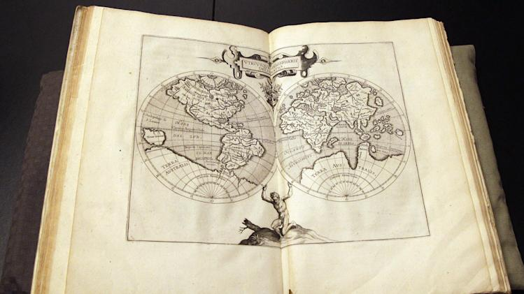 The world map page of the  Wytfliet Atlas is on display during a news conference, Wednesday, June 27, 2012 in New York.  The Wytfliet Atlas stolen a decade ago from the Royal Library of Sweden has been recovered in New York. (AP Photo/Mary Altaffer)
