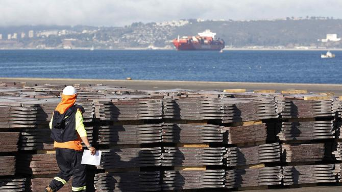 A port worker checks a copper shipment that is to be exported to Asia, in Valparaiso port