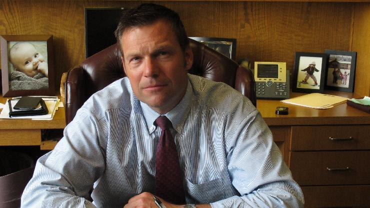 In this photo from Thursday, Aug. 1, 2013, Kansas Secretary of State Kris Kobach, the architect of the state's proof-of-citizenship law for new voters, is photographed during an Associated Press interview in Topeka, Kan. Kobach initiated a lawsuit by Kansas and Arizona against a federal agency to force the modification of a national voter registration form to help the states enforce their proof-of-citizenship laws. (AP Photo/John Hanna)