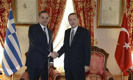 Greece's Prime Minister Antonis Samaras (L) shakes hands with his Turkish counterpart Recep Tayyip Erdogan before meeting in Istanbul March 4, 2013 in this photo provided by Turkish Prime Minister's Press Office. REUTERS/Kayhan Ozer/Turkish Prime Minister's Press Office/Handout (TURKEY - Tags: POLITICS) ATTENTION EDITORS - THIS IMAGE WAS PROVIDED BY A THIRD PARTY. FOR EDITORIAL USE ONLY. NOT FOR SALE FOR MARKETING OR ADVERTISING CAMPAIGNS. THIS PICTURE IS DISTRIBUTED EXACTLY AS RECEIVED BY REUTERS, AS A SERVICE TO CLIENTS