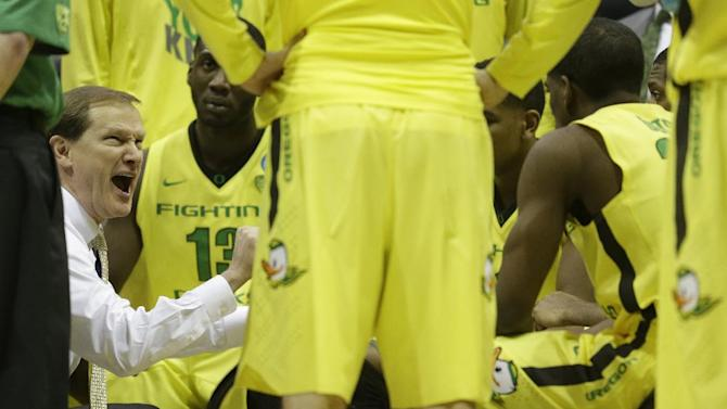 Oregon head coach Dana Altman talks to his team during a timeout during the second half of a second-round game against the BYU in the NCAA college basketball tournament Thursday, March 20, 2014, in Milwaukee. Oregon won 87-68