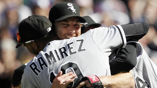 FILE - In this April 21, 2012, file photo, Chicago White Sox starting pitcher Philip Humber, center, is mobbed by teammates after pitching a perfect baseball game in their 4-0 win over the Seattle Mariners in Seattle. Seattle pitcher Felix Hernandez threw a perfect game, the Mariners' first ever and the 23rd in baseball history, against the Tampa Bay Rays in a 1-0 victory on Wednesday, Aug. 15. It was the third perfect game in baseball this season _ a first _ joining gems by Chicago's Humber against the Mariners in April and San Francisco Giants' Matt Cain versus the Houston Astros in June. (AP Photo/Elaine Thompson, File)
