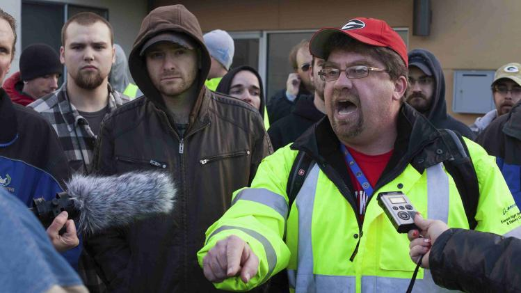 Union members who support a new vote on a contract for the Boeing 777X production argue with counter-protesters during a Boeing union rally in Everett