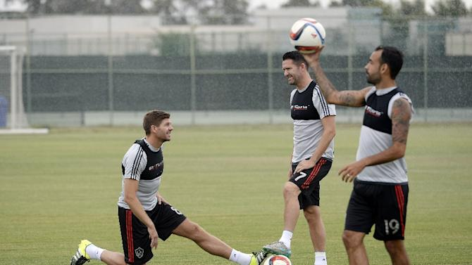 Los Angeles Galaxy players Steven Gerrard, Robbie Keane and Juninho attend a training session on July 7, 2015 at StubHub Center in Carson, California