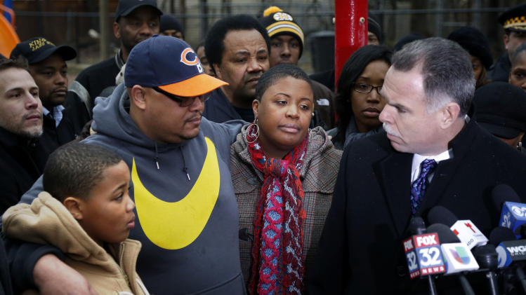 Chicago Police Superintendent Garry McCarthy, right, offers the city's condolences to the Pendleton family, from left, Nathaniel Jr., Nathaniel Sr., and Cleopatra during a news conference seeking help from the public in solving the murder of Pendleton's daughter Hadiya Wednesday, Jan. 30, 2013, in Chicago. Hadiya, 15, who had performed in President Barack Obama's inauguration festivities, was killed in a Chicago park as she talked with friends by a gunman who apparently was not even aiming at her. The city's 42nd slaying is part of Chicago's bloodiest January in more than a decade, following on the heels of 2012, which ended with more than 500 homicides for the first time since 2008. It also comes at a time when Obama, spurred by the Connecticut elementary school massacre in December, is actively pushing for tougher gun laws. (AP Photo/Charles Rex Arbogast)