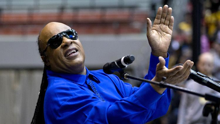 FILE - This Nov. 4, 2012 shows singer Stevie Wonder performing at a campaign event for President Obama at the Fifth Third Arena on the University of Cincinnati campus in Cincinnati. President Obama released an official playlist through the digital music service Spotify on Thursday, Jan. 18, 2013. The list includes songs by Stevie Wonder, Beyonce, John Legend, Usher, fun. and other acts set to perform during various inauguration events.  (AP Photo/Carolyn Kaster)