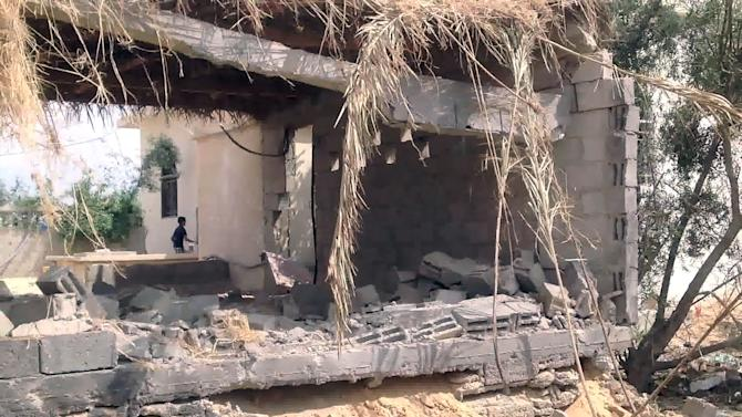 In this image taken from video, a damaged house is seen after Egyptian military helicopters targeted several locations along the border with Gaza, near Rafah, northern Sinai, Egypt, Tuesday, Sept. 3, 2013. Egyptian helicopter gunships fired rockets early Tuesday at militants in the northern Sinai Peninsula, killing nearly a dozens and injuring at least 15 others in an ongoing campaign to put down Islamic radicals who have escalated attacks in the largely lawless region, Egypt's official news agency said. (AP Photo/AP Television)