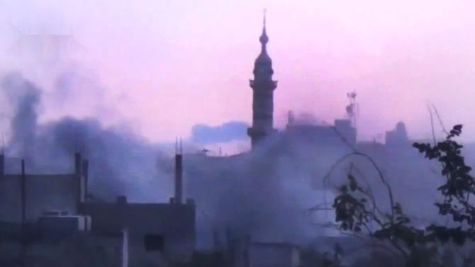 In this image made from amateur video released by the Shaam News Network and accessed Monday, June 25, 2012, smoke rises from buildings following purported shelling in Talbeesa, Homs, Syria. (AP Photo/Shaam News Network via AP video) TV OUT, THE ASSOCIATED PRESS CANNOT INDEPENDENTLY VERIFY THE CONTENT, DATE, LOCATION OR AUTHENTICITY OF THIS MATERIAL