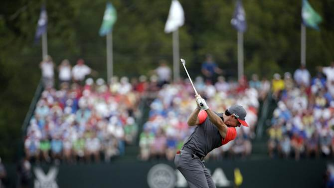 Rory McIlroy, of Northern Ireland, hits his tee shot on the eighth hole during the first round of the PGA Championship golf tournament at Valhalla Golf Club on Thursday, Aug. 7, 2014, in Louisville, Ky. (AP Photo/David J. Phillip)