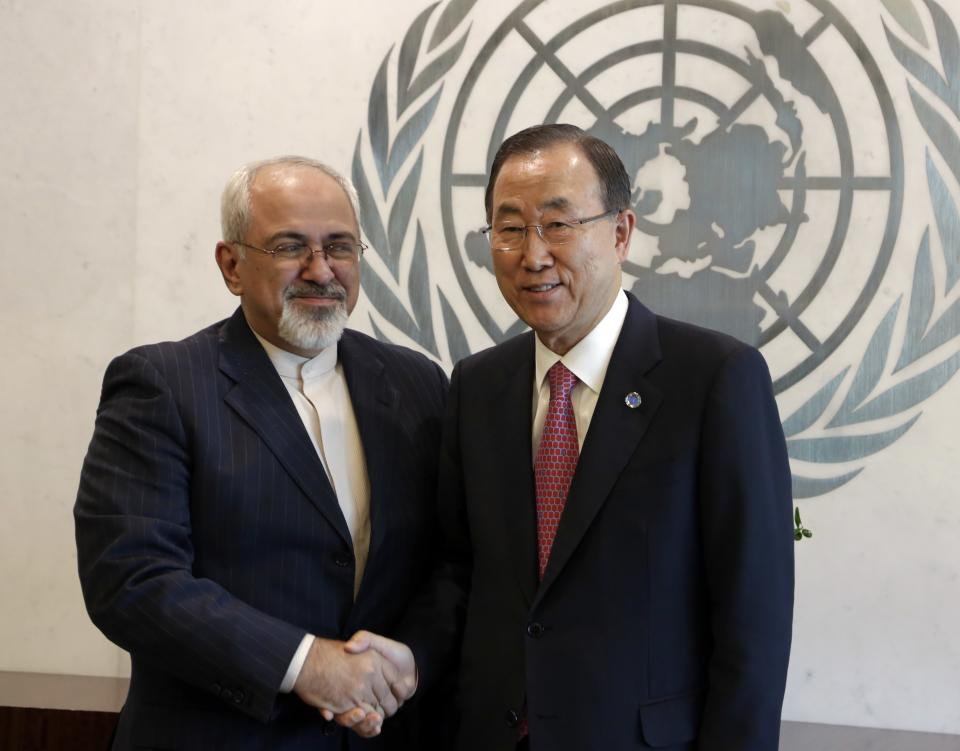 U.N. Secretary General Ban Ki-moon, left, shakes hands with Iran's Foreign Minister Javad Zarif at the beginning of their meeting at United Nations headquarters, Thursday, Sept. 19, 2013. (AP Photo/Richard Drew)