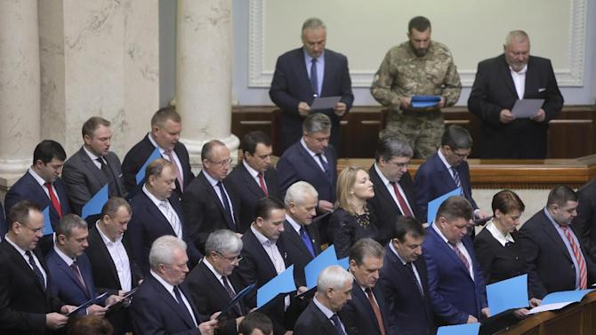 Newly elected Ukrainian parliament deputies swear their oath during the inauguration ceremony in Kiev, Ukraine, Thursday, Nov. 27, 2014. Ukraine Parliament in Ukraine has opened for its first session since an election last month that ushered in a spate of pro-Western parties. (AP Photo/Efrem Lukatsky)