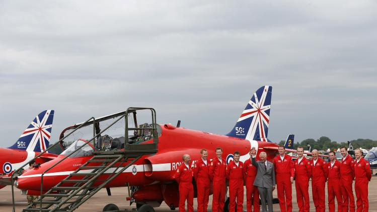 Britain's Prince Charles poses with pilots of The Royal Air Force aerobatic team during The Royal International Air Tattoo at the RAF in Fairford