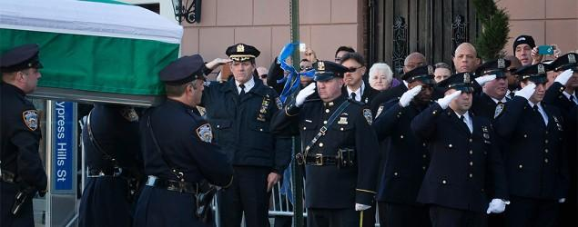 Friends, relatives gather for NYPD cop's wake