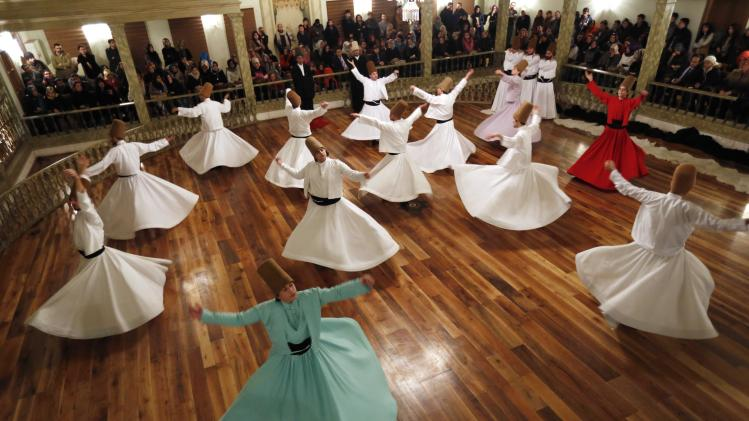 "Whirling Dervishes perform a traditional ""Sema"" ritual during a ceremony, one of many marking the 740th anniversary of the death of Mevlana Jalaluddin Rumi, in Istanbul"