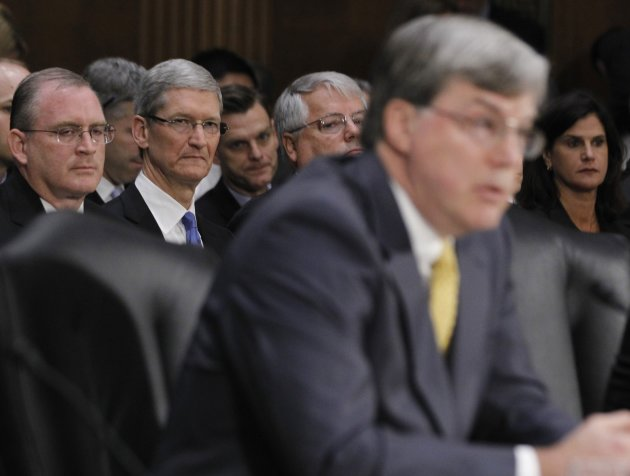 Apple CEO Cook is pictured in audience as he watches Villanova Professor Harvey testify before Senate homeland security and governmental affairs investigations subcommittee in Washington