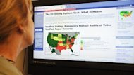 A woman reads information on the Verified Voting Federation website in October 2010, in Washington,DC. Pressure is building to make Internet voting widely available in the United States and elsewhere, even though technical experts say casting ballots online is far from secure