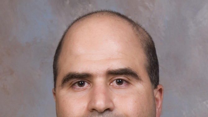 The 2007 file photo provided by the Uniformed Services University of the Health Sciences (USUHS) shows Maj. Nidal Malik Hasan.  Hasan, charged in the 2009 Fort Hood shooting rampage, wants his upcoming murder trial moved off the Texas Army post. (AP Photo/USUHS, File)