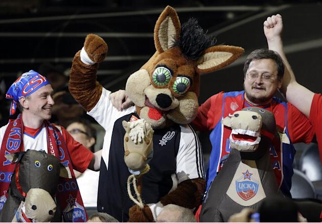 San Antonio Spurs mascot, Coyote, center, jokes with CSKA Moscow fans during the second half of an exhibition NBA basketball game against the San Antonio Spurs, Wednesday, Oct. 9, 2013, in San Antonio