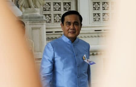 Thailand's Prime Minister Chan-ocha arrives at the Government House  before the first cabinet meeting in Bangkok