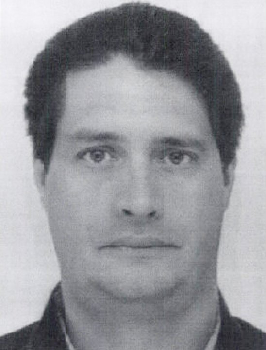 This undated photo provided by Interpol shows Shawn Sullivan. Britain's High Court on Thursday, June 28, 2012, blocked a U.S. government bid to extradite Sullivan to Minnesota, saying the state's rest