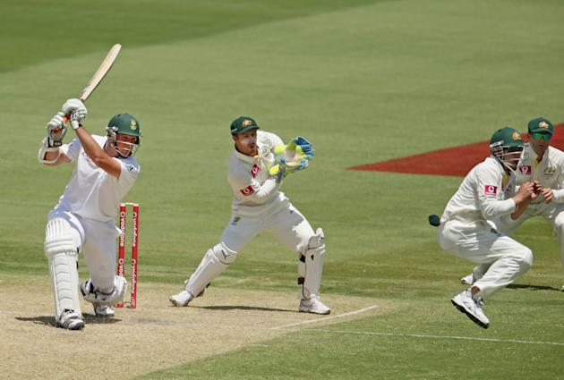 ADELAIDE, AUSTRALIA - NOVEMBER 23:  Graeme Smith of South Africa hits a boundary as Michael Clarke and Matthew Wade of Australia look on during day two of the Second Test match between Australia and S