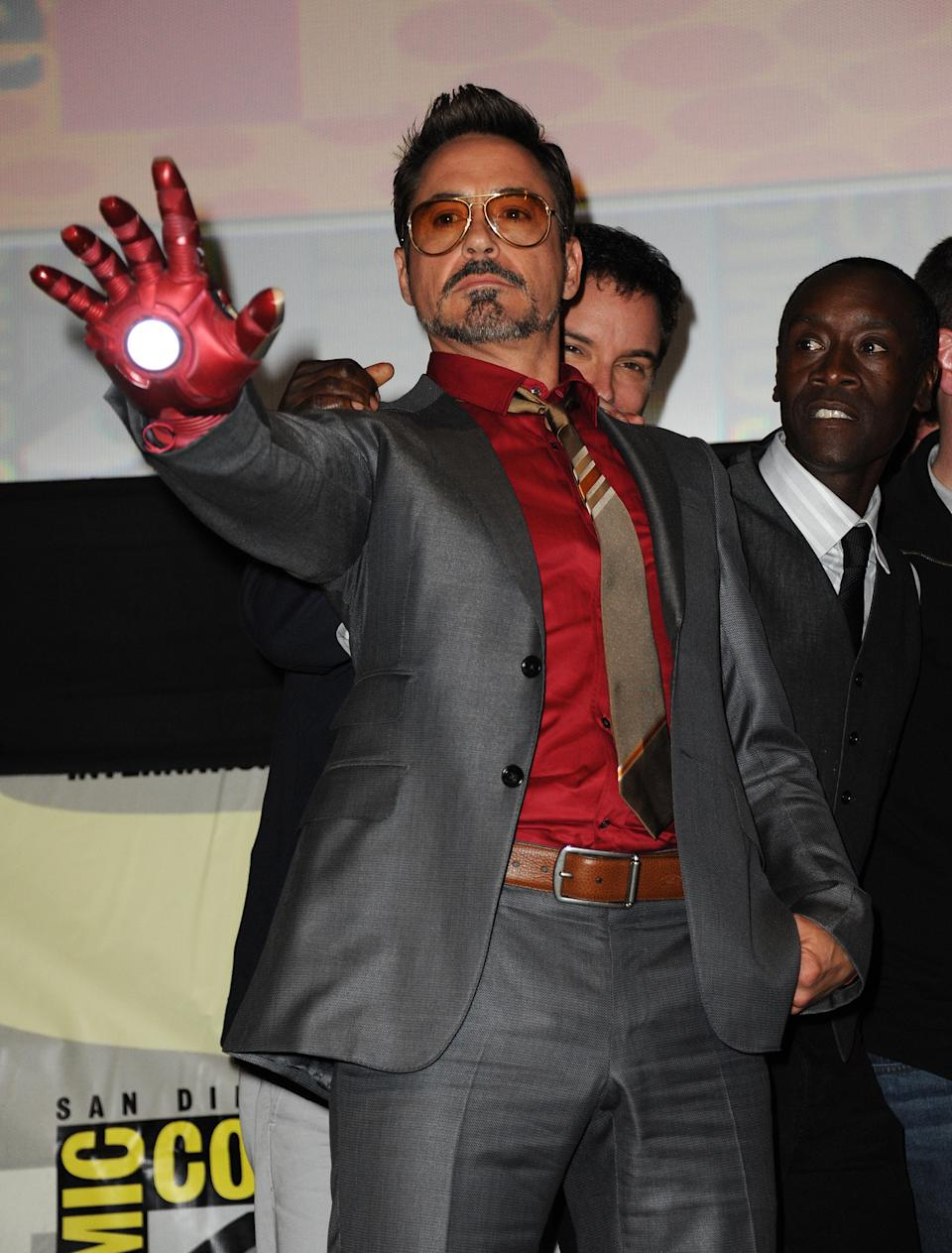 "Robert Downey Jr. poses at the ""Iron Man 3"" panel 2012 Comic Con on Saturday, July 14, 2012 in San Diego, Calif. (Photo by Jordan Strauss/Invision/AP)"