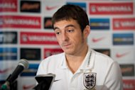 England football squad member Leighton Baines speak to journalists near Watford, England, on October 13, 2013