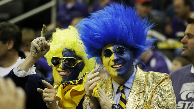 La Salle fans Daniel DeSefano, left, and Douglas LeVien cheer for  their team before the start of a second-round game against Kansas State in the NCAA basketball tournament at the Sprint Center in Kansas City, Mo., Friday, March 22, 2013. (AP Photo/Orlin Wagner)