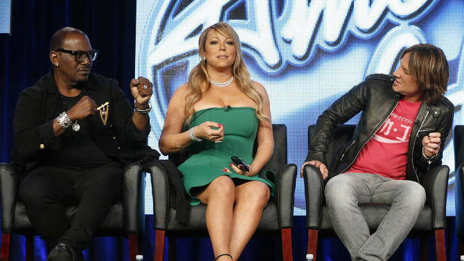 "Randy Jackson, Mariah Carey and Keith Urban from ""American Idol"" attend the Fox Winter TCA Tour at the Langham Huntington Hotel on Tuesday, Jan. 8, 2013, in Pasadena, Calif. (Photo by Todd Williamson/Invision/AP)"