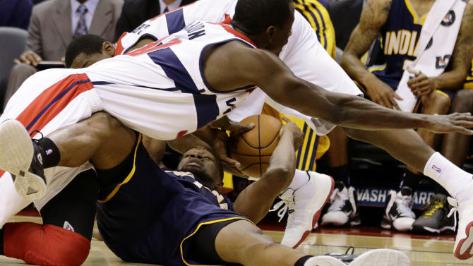 Washington Wizards center Earl Barron, top, dives for the ball as Indiana Pacers forward Sam Young holds on to it, during the first half of an NBA basketball game Monday, Nov. 19, 2012, in Washington.( AP Photo/Alex Brandon)