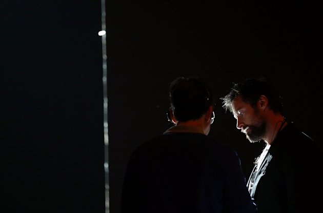Actor Hugh Jackman, right, attends rehearsals for the 85th Academy Awards in Los Angeles, Friday, Feb. 22, 2013. The Academy Awards are scheduled for Sunday, Feb. 24, 2013. (Photo by Matt Sayles/Invision/AP)