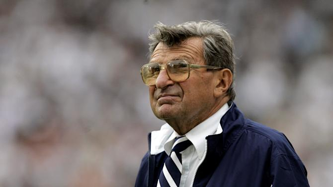 FILE- In this Sept. 16, 2006 photo, Penn State coach Joe Paterno watches the college football game against Youngstown State from the side lines in State College, Pa. When Penn State opens its football season on Saturday, Sept. 1, 2012, for the first time since 1965, no one with the last name of Paterno will be on the sidelines. Paterno died of cancer in January 2012, just months after losing his job in the wake of the Jerry Sandusky sex abuse scandal. (AP Photo/Carolyn Kaster, File)