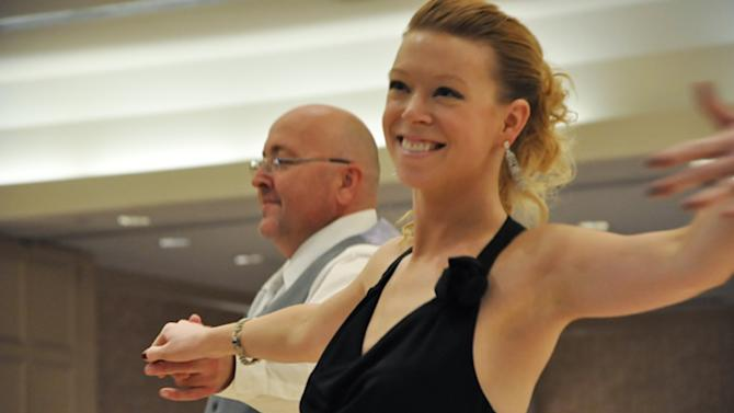 This 2012 photo provided by the Arthur Murray Boston Studio shows Adrianne Haslet during a dance competition in the Boston area. Haslet, a professional ballroom dancer injured by one of the bombs that exploded near the Boston Marathon finish line, on Monday, April 15, 2013, vows she will dance again. (AP Photo/Arthur Murray Boston Studio)