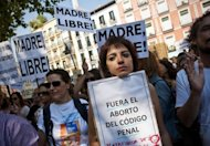 Women hold signs as they take part in a protest against a reform of Spain&#39;s abortion law at Tirso de Molina Square in Madrid