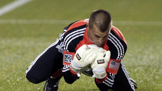 San Jose Earthquakes goalie Jon Busch stops a shot during the first half of an MLS soccer match against the Portland Timbers in Portland, Ore., Sunday, April 14, 2013. (AP Photo/Don Ryan)